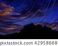 Long exposure image showing Night sky star trails 42958668