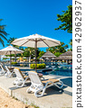 Beautiful tropical beach and sea with umbrella and chair around swimming pool 42962937