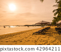 Umbrella and chair on the tropical beach sea and ocean at sunrise time 42964211