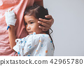 Sick asian little child girl hugging her mother 42965780