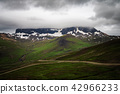 Green mountain with dramatic sky ,Iceland. 42966233
