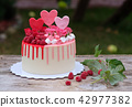 beautiful homemade cake with pink and red cream 42977382