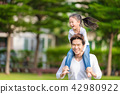Cute Asian girl on neck dad big happy laughing. 42980922