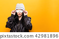 Fashionable woman on a solid background 42981896