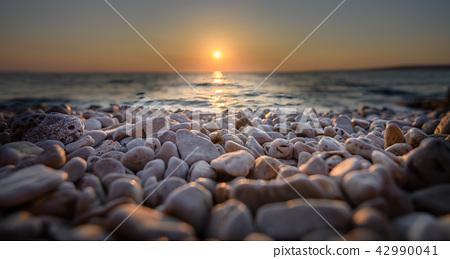 Beach pebbles at sunset, close up macro 42990041