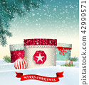 Christmas background with gift boxes in snow 42999571