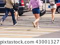young woman feet running an urban street 43001327
