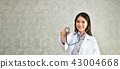 Smiling doctor posing in the office, She is wearing a stethoscop 43004668