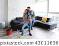 Man And Woman Dancing While Cleaning Home 43011636