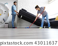 Man And Woman Doing Chores Cleaning Floor 43011637
