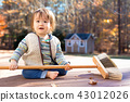 Happy toddler boy playing outside 43012026