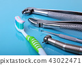 dental care toothbrush with dentist tools. 43022471