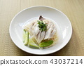 steamed rice topping boiled chicken on bamboo mat 43037214