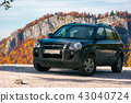 SUV on the road in mountains 43040724