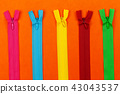 set of colorful zipper on orange paper background 43043537