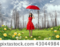 Woman in red dress with umbrella in dry forest 43044984