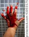 Hand of depressed woman covered with fresh blood 43055575