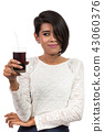 Pretty asian woman with glass of cola. Studio shot 43060376