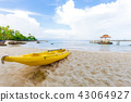 Nice tropical white sand beach with kayak boat 43064927