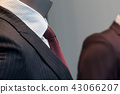 suit and tie on mannequin in a fashion store  43066207