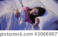 woman insomnia on bed 43066967