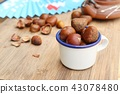 chestnuts seed on wood 43078480