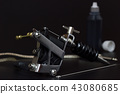 Tattoo machines and Bottles tattoo Ink in darkness 43080685