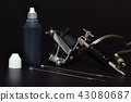 Tattoo machines and Bottles tattoo Ink in darkness 43080687