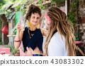 Happy stylish woman feeling thankful looking at her boyfriend 43083302