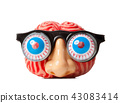 Rubber brain with funny nose and glasses. 43083414