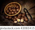 Macadamia nuts on wooden table. 43083415