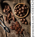 Macadamia, Pecan and Pili nuts on wooden table 43083424
