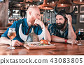 Two men wearing Vikings hats feeling unsatisfied with service in pub 43083805