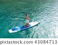 Sea series: Asian woman paddling SUP board 43084713