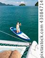 Sea series: Asian woman paddling SUP board 43084714