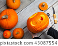 Girl worked on wooden table with pampkin for halloween 43087554