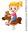Little girl playing rocking horse 43091312