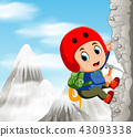 Young man while climbing challenging route on clif 43093338