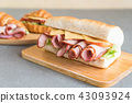 Ham and salad submarine sandwich 43093924
