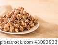 Chocolate covered popcorn 43093933