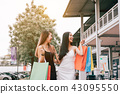 Asian female friends holding shopping bag 43095550