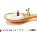 Miniature little children standing on a wooden 43096800