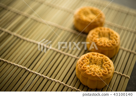 Moon cakes on bamboo mat with copy space 43100140