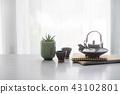 Japanese ceramic tea pot and tea cup  on table 43102801