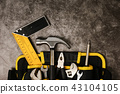 Construction worker belt with tools on concrete texture backgrou 43104105