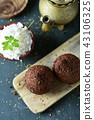 kibbeh, a levantine dish, on a rustic wooden table 43106325
