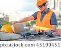 Asian engineer using drone, laptop for site survey 43109451