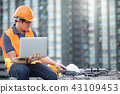 Asian engineer using drone, laptop for site survey 43109453