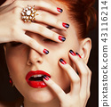 beauty stylish redhead woman with hairstyle wearing jewelry 43116214