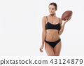 Slim lady in underwear with rugby ball 43124879